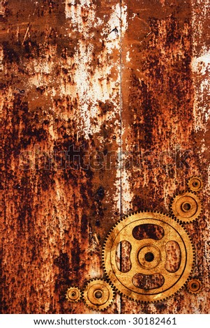 Gear on rusty metal background - stock photo