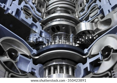 Gear shaft of automotive transmission with grey nuts, bolts and blue color coating, gearbox for oversize trucks, SUV, cargo, commercial and construction vehicles, selective focus  - stock photo