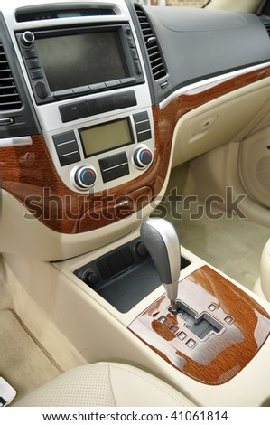 Gear shift and center console for a new car's interior - stock photo