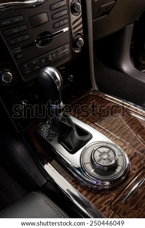Gear shift in car. Detail interior of modern auto.