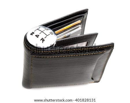 Gear shift marks on a wallet as a concept related with spending of money. - stock photo