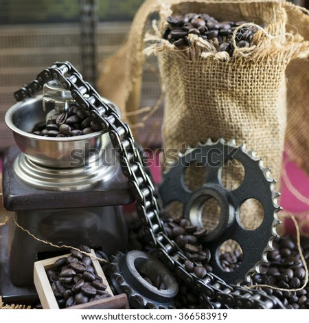 Gear, sprockets, chain for car engine, coffee and texture of burlap sock - stock photo