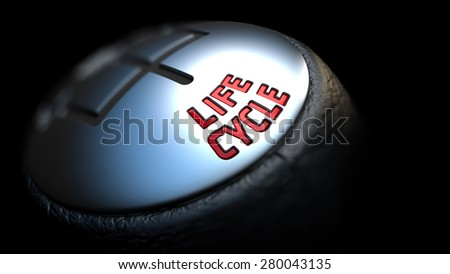 Gear Stick with Red Text Life Cycle on Black Background. Close Up View. Selective Focus. Control Concept. - stock photo
