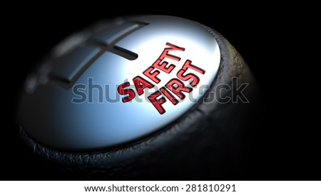 Gear Stick with Red Text Safety First on Black Background. Selective Focus. 3D Render. - stock photo