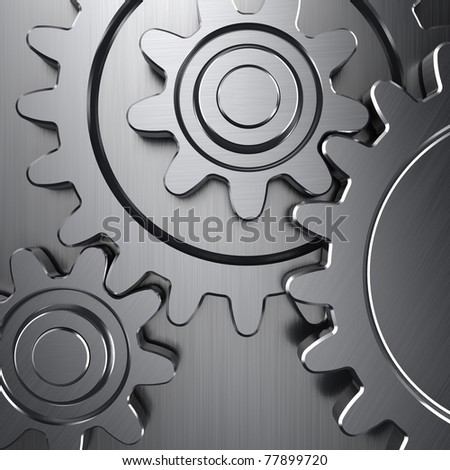 Gear wheels on metal surface - stock photo