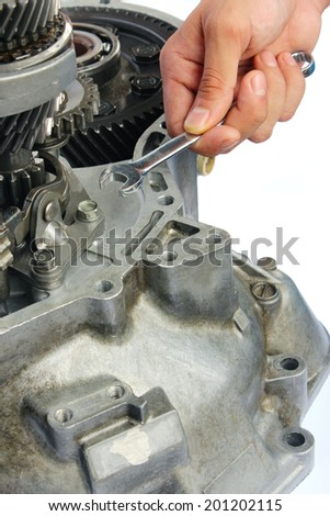 gearbox repairing work on isolated background - stock photo