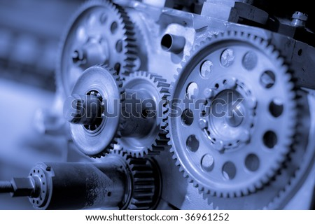 Gears, aircraft power engine details. Industrial machinery background.