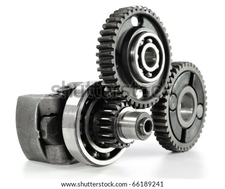 Gears and bearings connecting on white background