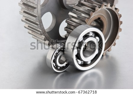 gears and bearings on a metal plate - stock photo
