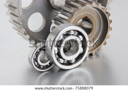 gears and bearings on a metal plate