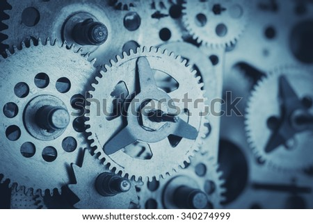 Gears and cogs close-up, blue toned - stock photo