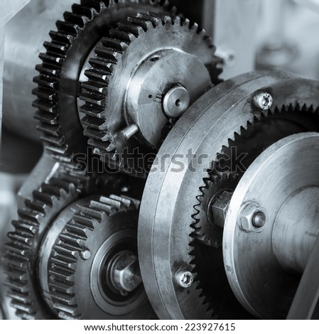 Gears and cogs of old machine close up - stock photo