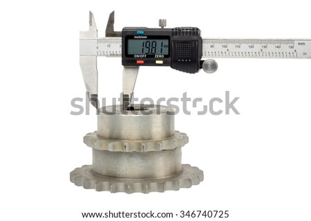 Gears and electronic caliper, on white background - stock photo