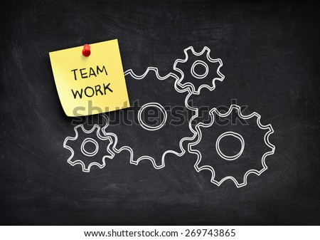Gears and teamwork note paper - stock photo