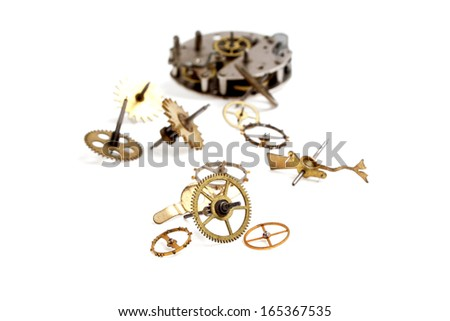 Gears from old clock isolated on white background - stock photo