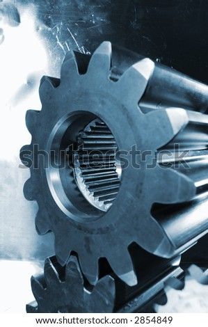 gears in blue against buckled steel background, wide perspective