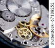 gears in disassembled wristwatch close up - stock photo
