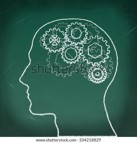 Gears in The Human Head drawing on the chalkboard - stock photo