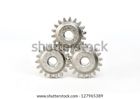 Gears linked together on white background - stock photo