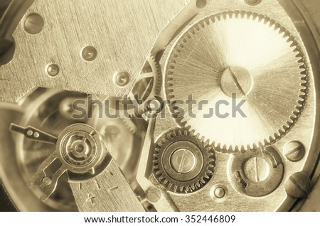 Gears old mechanical watches. Pendulum, cogs under the hood. Close up view, selective focus. Vintage toning. Morning fog glow. - stock photo