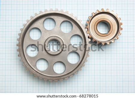 gears on graph paper - stock photo