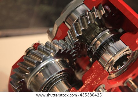 Gears with shaft and bearings in the gearbox housing - stock photo