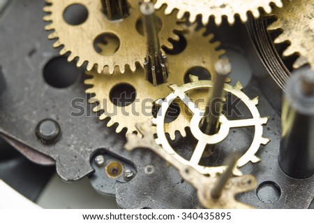 Gearwheels inside clock mechanism. Concept Teamwork , Idea Technology