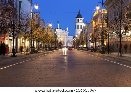 Gediminas Avenue in Vilnius at night with floodlit buildings - stock photo