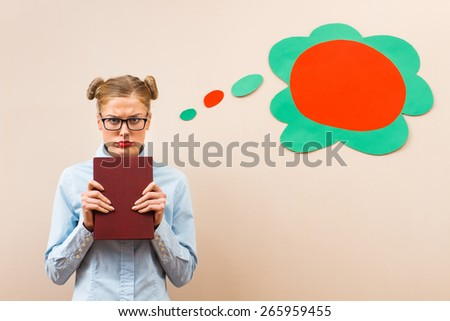 Geek girl is sad and angry because she has got to learn.I hate to learn! - stock photo