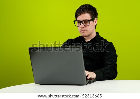 Geek in black shirt working on computer - stock photo