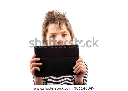 Geek kid holding a tablet device in front of him - stock photo