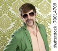 geek retro salesperson man funny mustache sunglasses in green wallpaper - stock photo