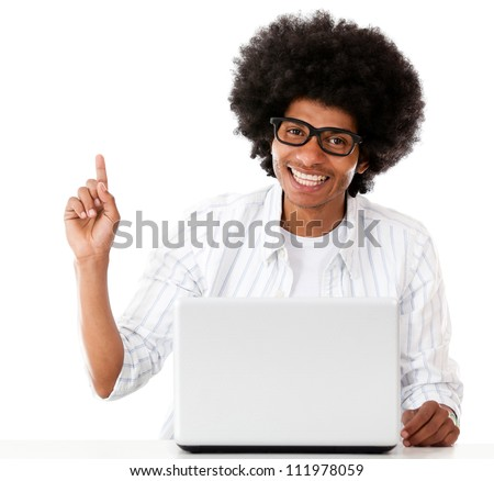 Geek with a laptop pointing an idea - isolated over a white background - stock photo