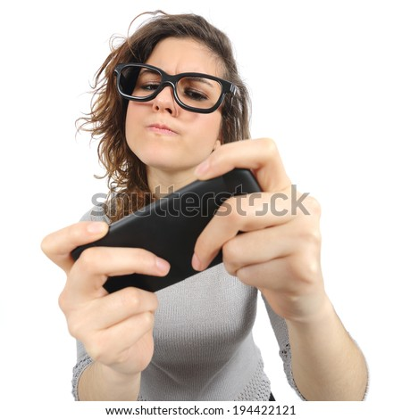 Geek woman playing with a smart phone isolated on a white background           - stock photo
