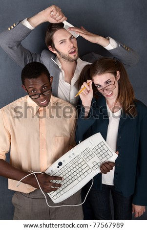 Geeks with keyboard, salesman comb and pencil making faces - stock photo