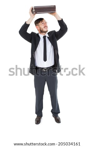 Geeky businessman holding briefcase over head on white background