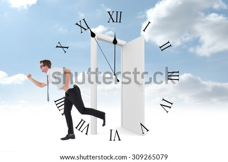 Geeky businessman running late against clock counting down to midnight - stock photo