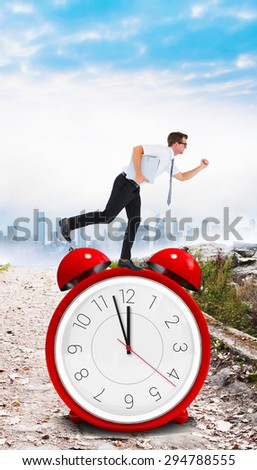 Geeky businessman running late against stony path leading to misty cityscape - stock photo
