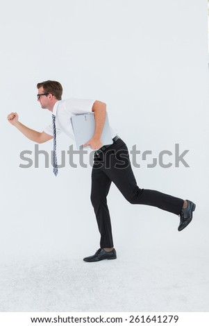 Geeky businessman running late on white background - stock photo