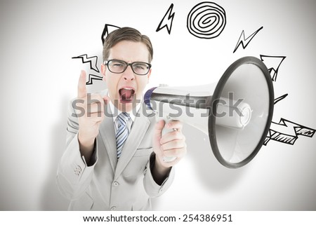 Geeky businessman shouting through megaphone against white background with vignette - stock photo