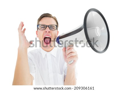 Geeky businessman shouting through megaphone on white background - stock photo