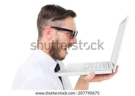 Geeky frustrated businessman looking at his laptop on white background