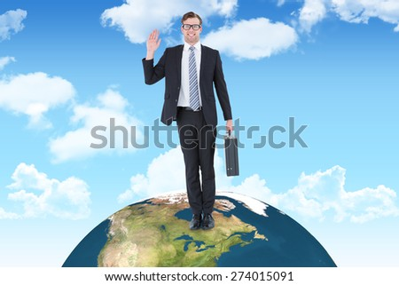 Geeky hipster businessman waving at camera against blue sky - stock photo