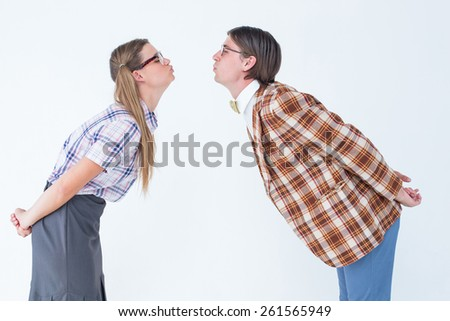 Geeky hipster couple kissing on white background