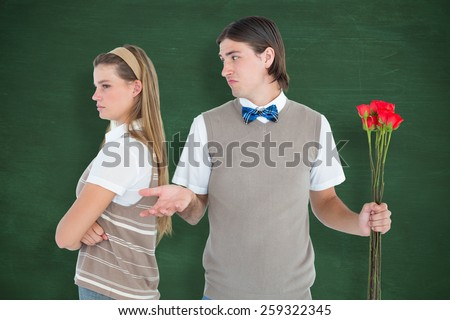 Geeky hipster couple not talking after argument against green chalkboard - stock photo