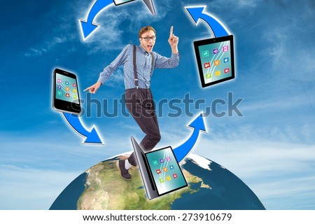 Geeky hipster dancing to vinyl against blue sky - stock photo