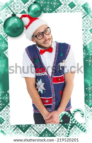 Geeky hipster in santa hat against christmas frame - stock photo