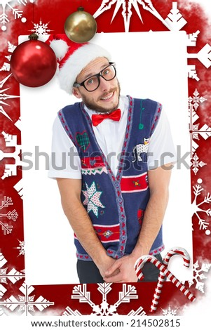 Geeky hipster in santa hat against christmas themed page - stock photo