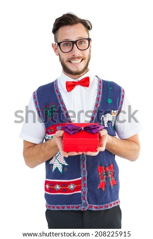 Geeky hipster offering christmas gift on white background - stock photo