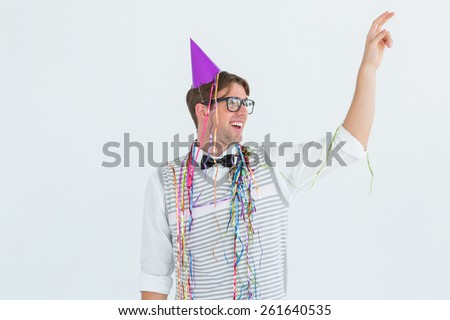 Geeky hipster pointing something on white background - stock photo